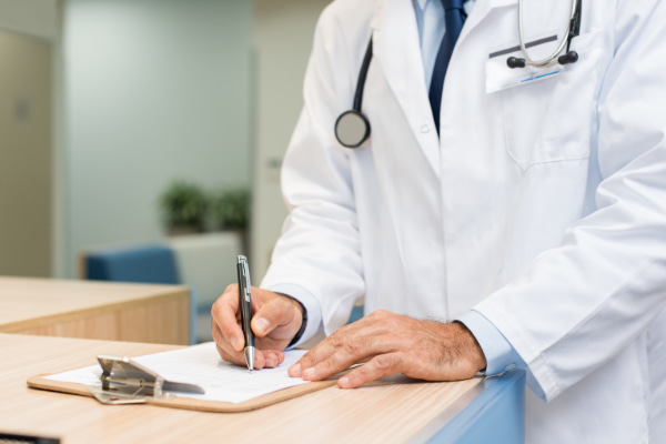 What does a DOT physical exam consist of | Doctor taking notes about the exam
